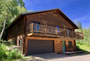 front of The Aspens Lodge